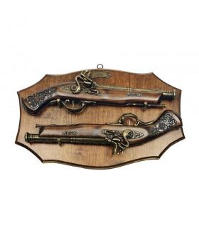 Panoplia di legno con le pistole